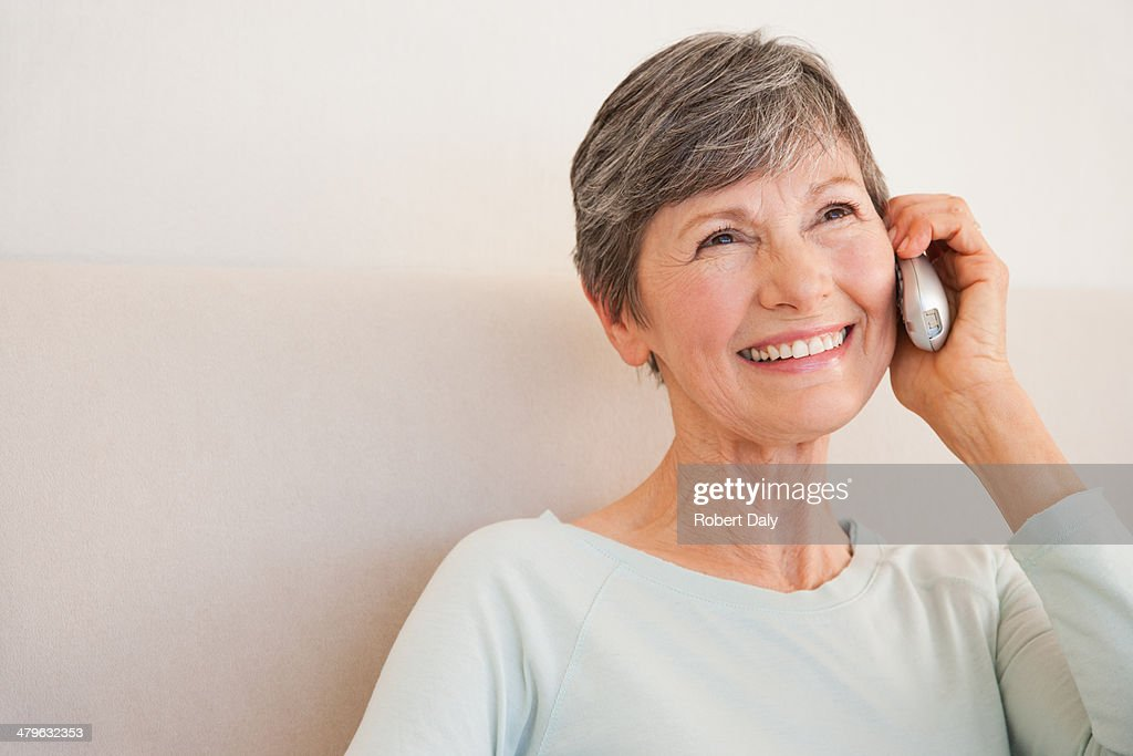 a senior woman on her cellular phone  : Stock Photo