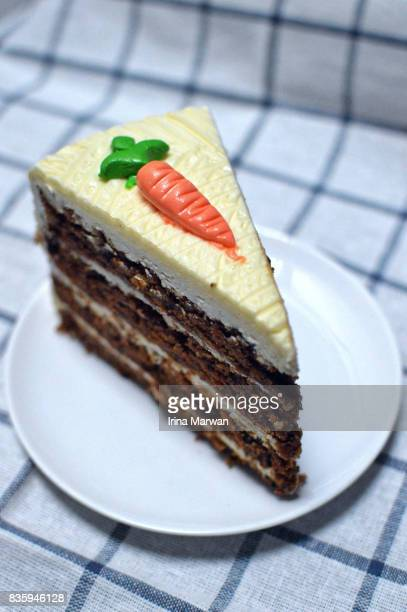 a slice of carrot cake - carrot cake stock pictures, royalty-free photos & images