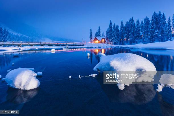 a small resort lodge at lakeshore in winter landscape - deep snow stock pictures, royalty-free photos & images