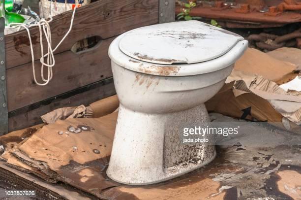 a soiled white toilet bowl