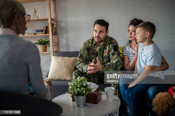 a soldier and his family at a psychotherapist during a session