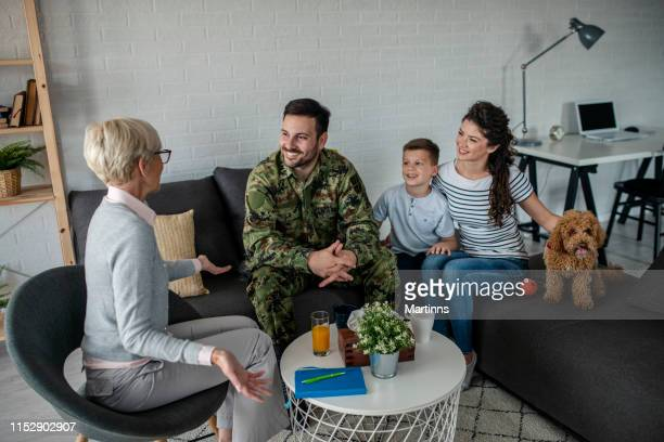 a soldier and his family at a psychotherapist during a session - military uniform stock pictures, royalty-free photos & images