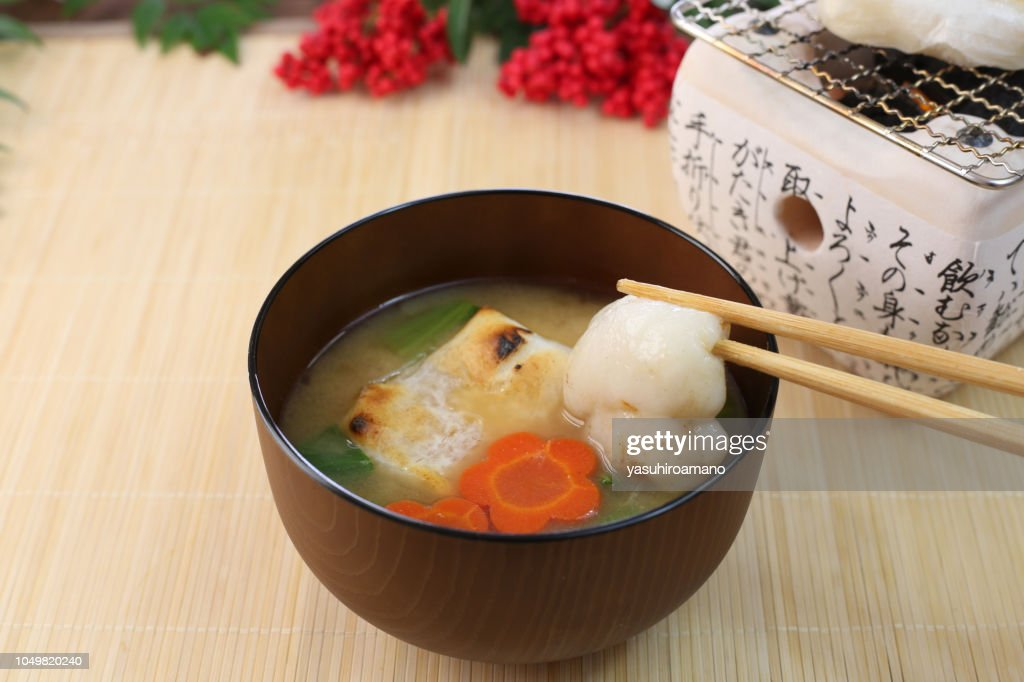 a soup containing rice cakes, eaten on New Year's day : Stock Photo