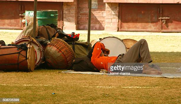 A street performer resting after a hard day's performance