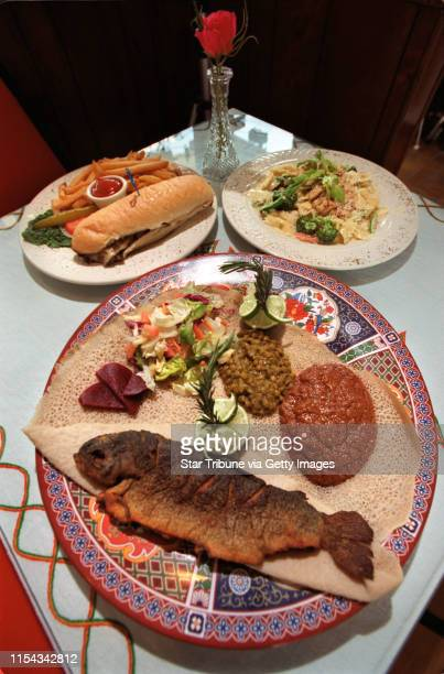 a strip mall of several interesting ethnic restaurants At the Queen of Sheba you can get Asa Tibs 10oz lightly dusted Pan fried rainbow trout served...