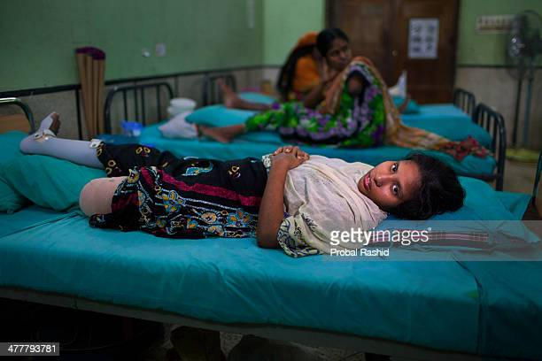 a survivor of the Rana Plaza building collapse having treatment in a hospital at Savar During the incident she was working on the 2nd floor of the...