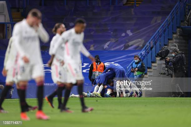 A television camera points at the celebrating Chelsea players as Madrid know that they are beaten during the UEFA Champions League Semi Final Second...