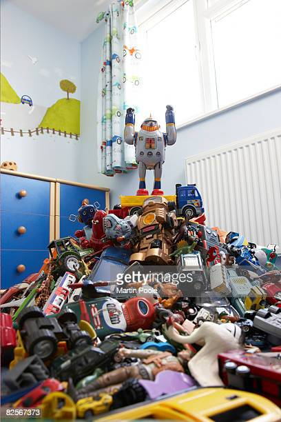a toy robot on top of pile of ro