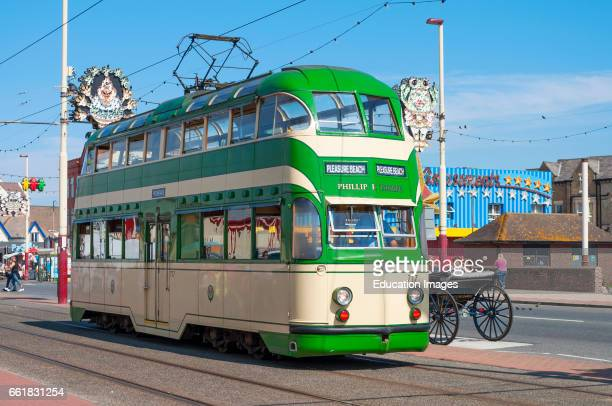a traditional tram or trolley bus in the seaside town of blackpool lancashire England Britain UK