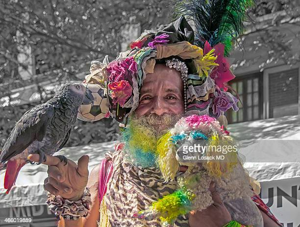 CONTENT] a transvestite man who frequents the Gay parade each year He carries his dog and parrot with him to the event Manhattan NY USA