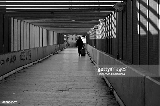 CONTENT] a traveler is going through a tunnel that leads to the train station