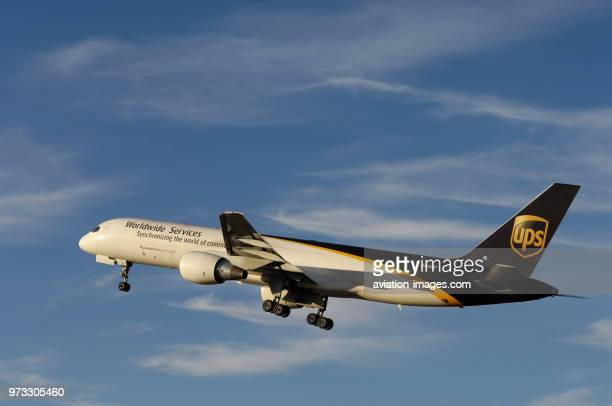 a UPS United Parcel Service Boeing 757200 climbing out after takeoff with undercarriage retracting