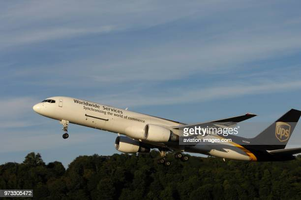 A UPS United Parcel Service Boeing 757-200 climbing out after take-off with undercarriage retracting.