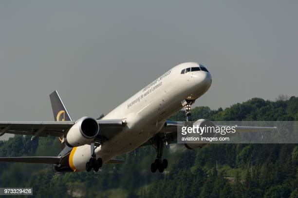 A UPS United Parcel Service Boeing 757-200 freighter climbing out after take-off.