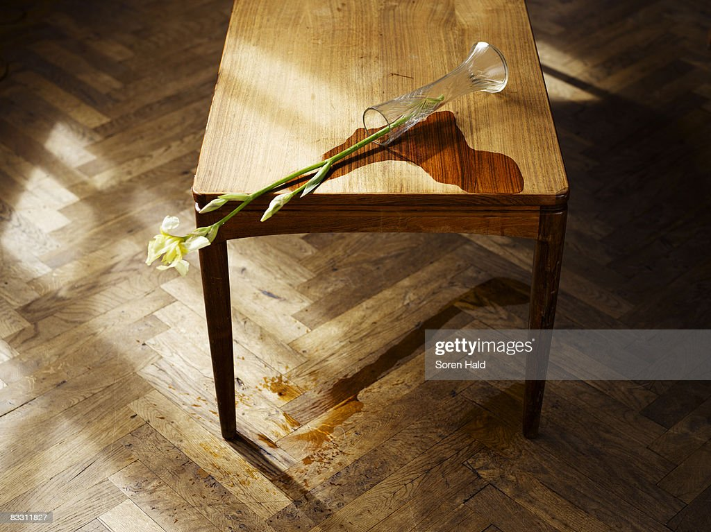 A Vase Knocked Over On A Table With Spilled Water Stock Photo
