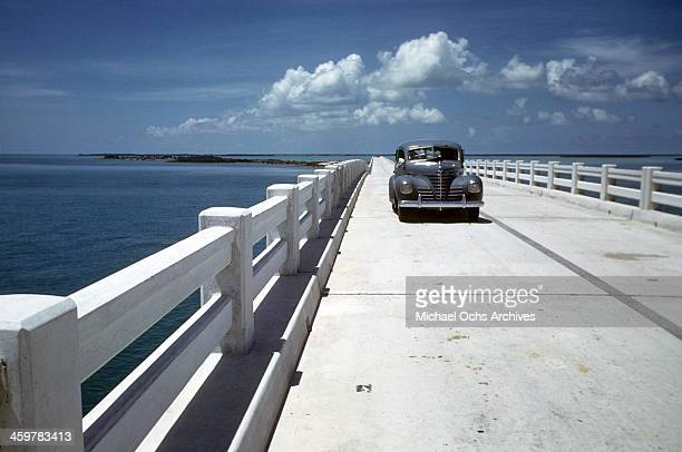 a view of a car traveling on the Seven Mile Bridge part of the Overseas Highway US 1 in the Florida Keys Florida