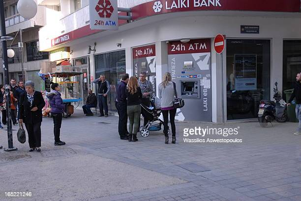 CONTENT] a view on the popular bank in Nicosia Cyprus during the days of the crisis in March 2013