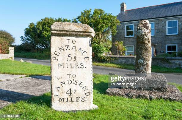 a vintage distance marker on the roadside in Cornwall England UK