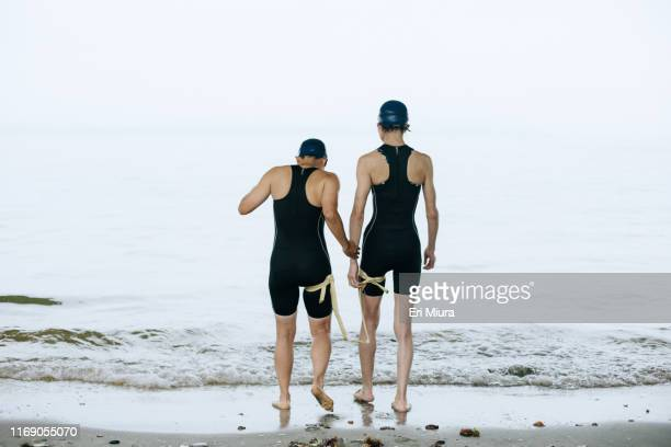 a visually impaired female triathlete and her guide at sea