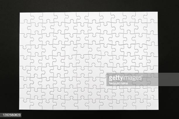 a white jigsaw puzzle - puzzle stock-fotos und bilder