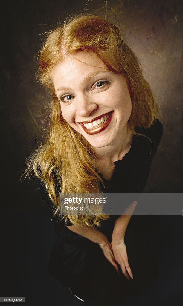 a wide angle image of a perky red-haired young woman : Stockfoto