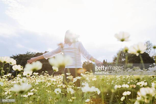 a woman at the flower field