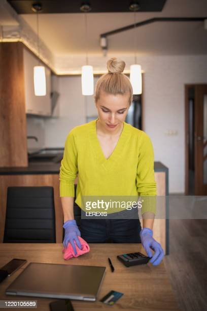 a woman cleans the table at home - tidy room stock pictures, royalty-free photos & images