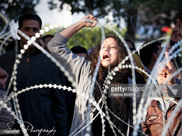 A woman cries in front of the ministry of interior in tunis asking islamist gouvernment to find the murderers of chokri belaid, political opponent...
