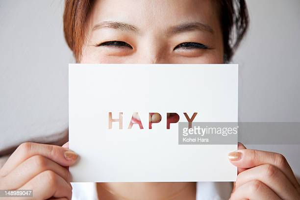 a woman holding a card - greeting card bildbanksfoton och bilder