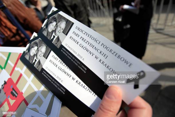 a woman holds two tickets to the ceremony of mourning of Polish President Lech Kaczynski and his wife Maria for the closedoff areas on April 17 2010...