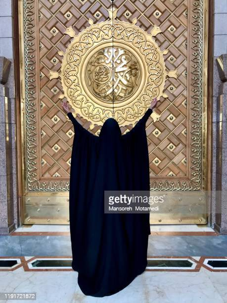 a woman infront of the king abdul azeez gate of prophet's mosque, medina - muhammad prophet stock pictures, royalty-free photos & images