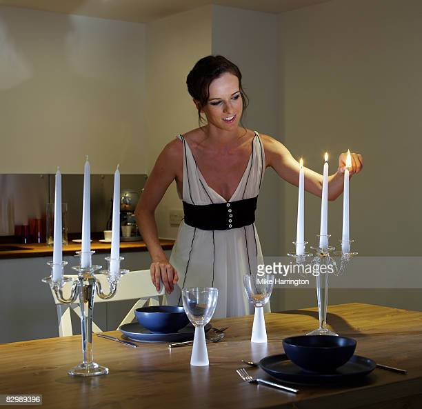 a woman lighting a candle