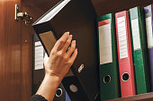 a woman officer pick a binder of document