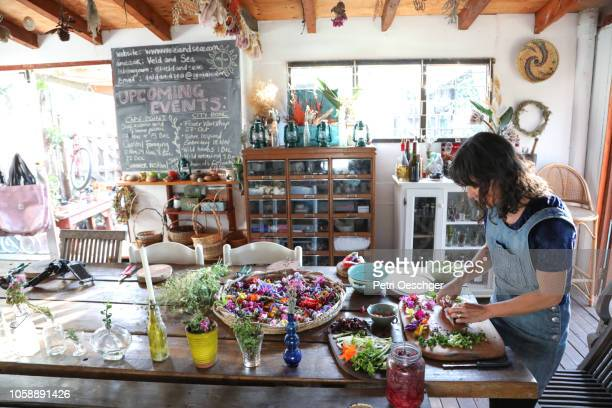 a Woman preparing the food she foraged in her kitchen.