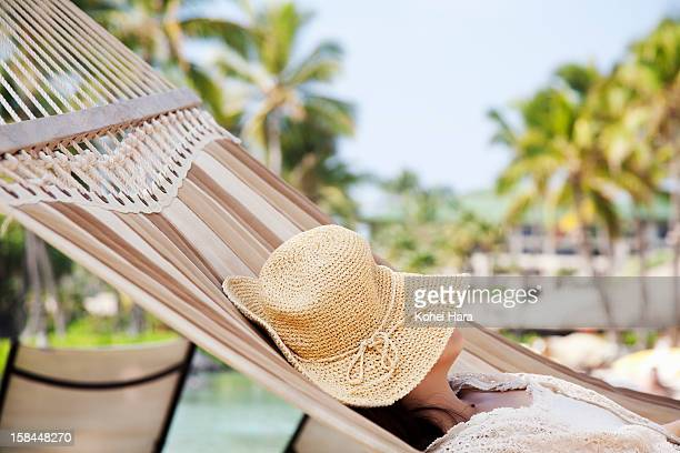 a woman sleeping on hammock - sun hat stock pictures, royalty-free photos & images