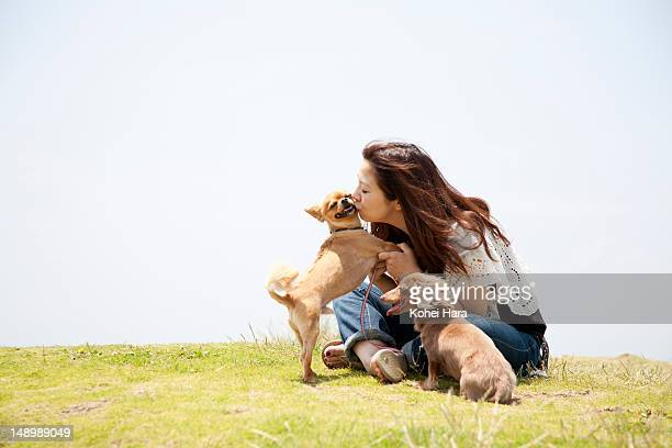 a woman with two dogs - two animals stock pictures, royalty-free photos & images