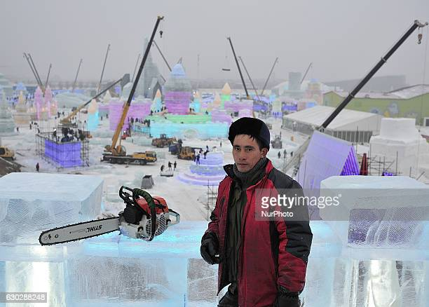 a worker carving ice sculpture at Ice and Snow World park in Harbin city of China on December 20 2016China's northernmost province of Heilongjiang...