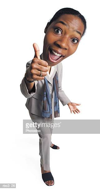 a young african american business woman smiles with enthusiasm as she gives the thumbs up