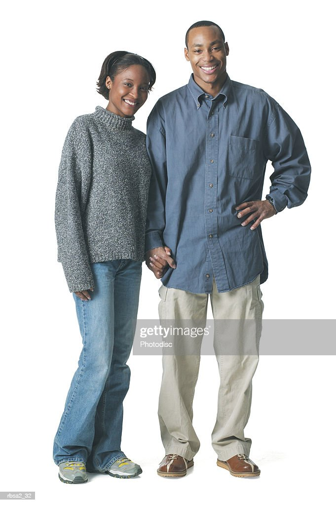 a young african american couple stands together and smile : Foto de stock