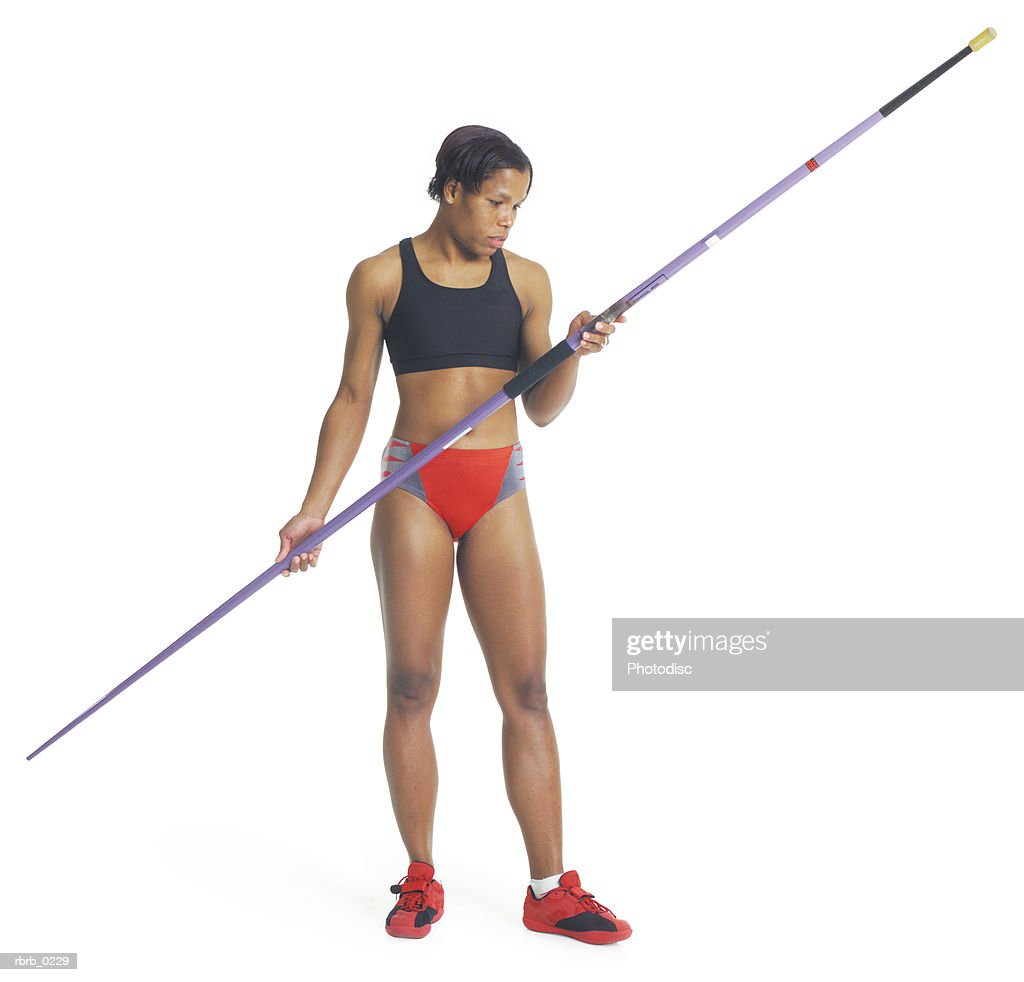 a young african american female athlete in red and black holds the javelin and prepares for the javelin throw : Stockfoto