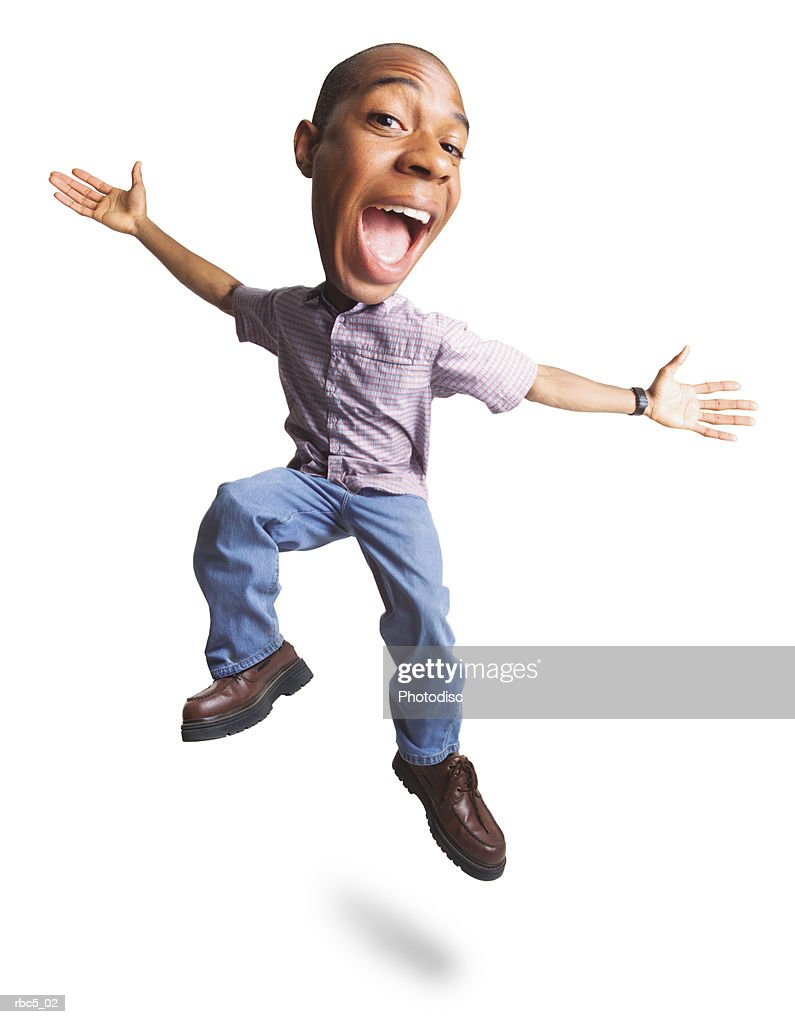 a young african american male leaps into the air while spreading his arms out widely and smiling : Stockfoto