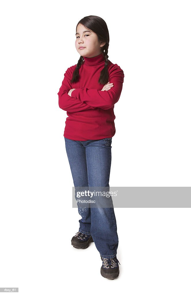a young asian girl in jeans and a red sweater folds her arms and glares into the camera : Foto de stock