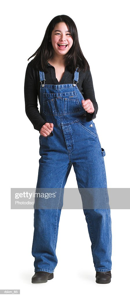 A Young Asian Girl In Overalls Busts A Move And Playfully Dances Stock Photo  Getty -4578