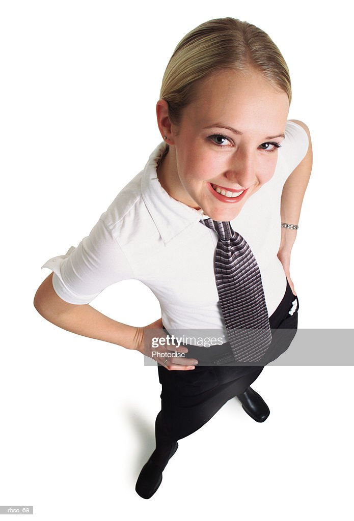 a young attractive caucasian waitress in a black skirt and tie smiles as she looks up at the camera : Foto de stock