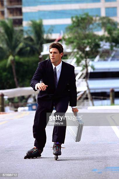 a young businessman wearing roller blades and carrying a briefcase