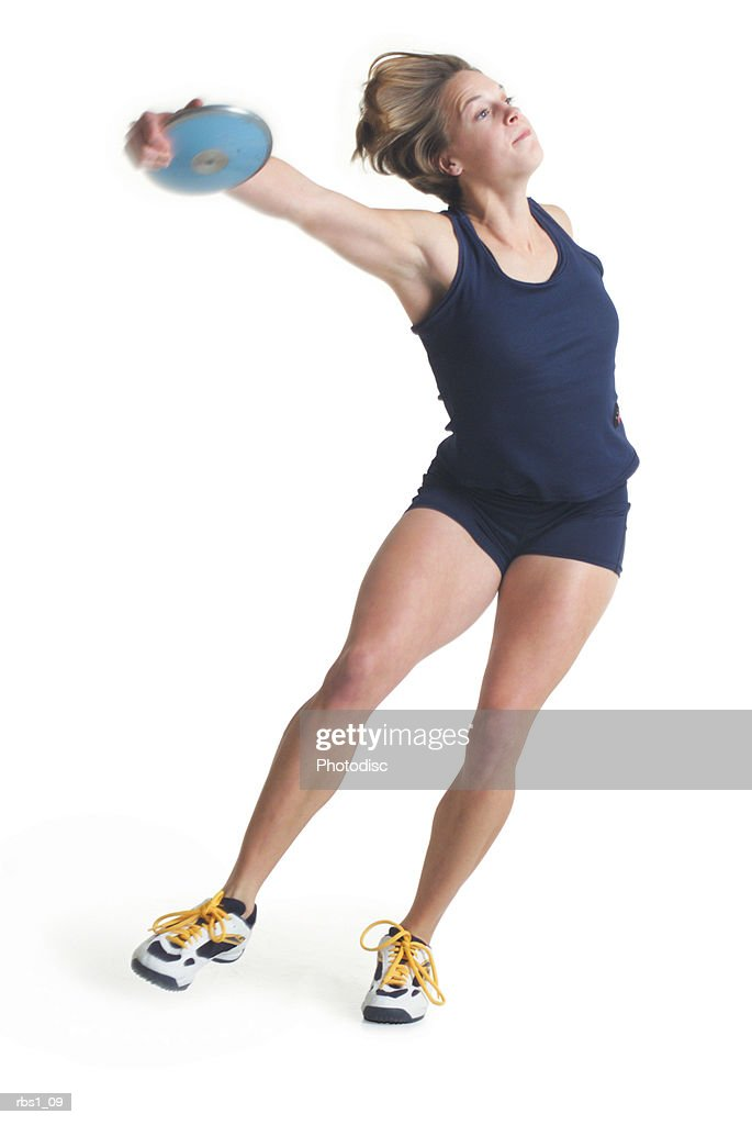 a young caucasian female athlete is wearing a dark uniform and about to throw a discus : Foto de stock