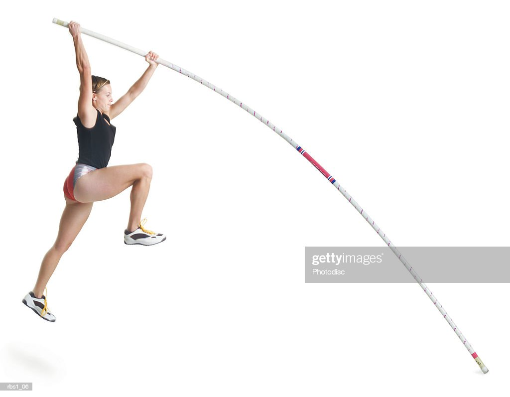 a young caucasian female athlete wearing a black and red uniform is starting a pole vault : Foto de stock