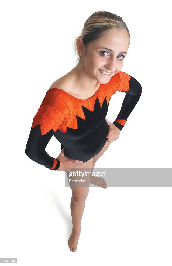 a young caucasian female gymnist in a red and black leotard smiles as she looks up into the camera : Foto de stock