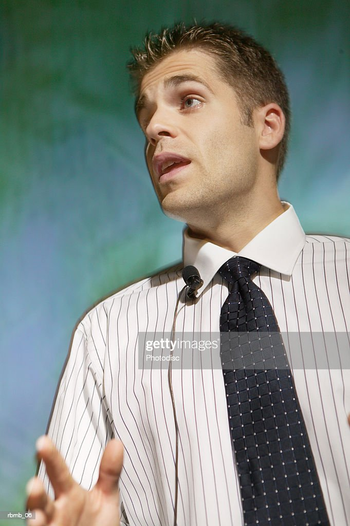 a young caucasian man in a shirt and tie speaks while giving a presentation : Stockfoto