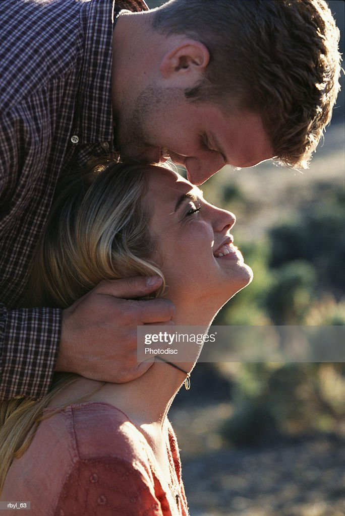 a young couple are close together being romantic and close : Foto de stock